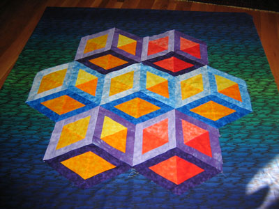 The image above shows a Necker cube pattern emblazoned on a quilt ...